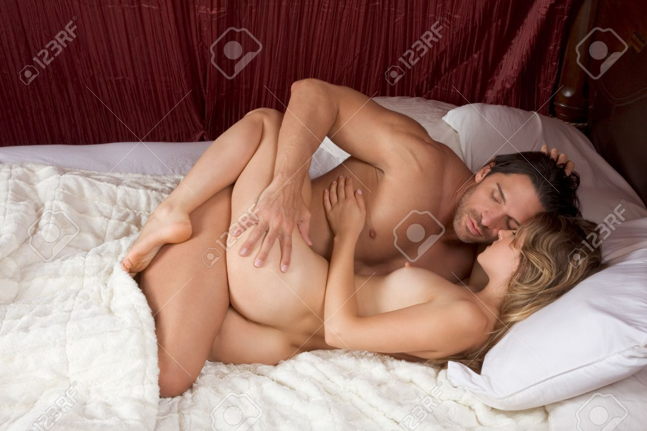 Couples in love in bed nakes